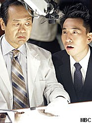 Image of Ando and a scientist from 'Heroes'